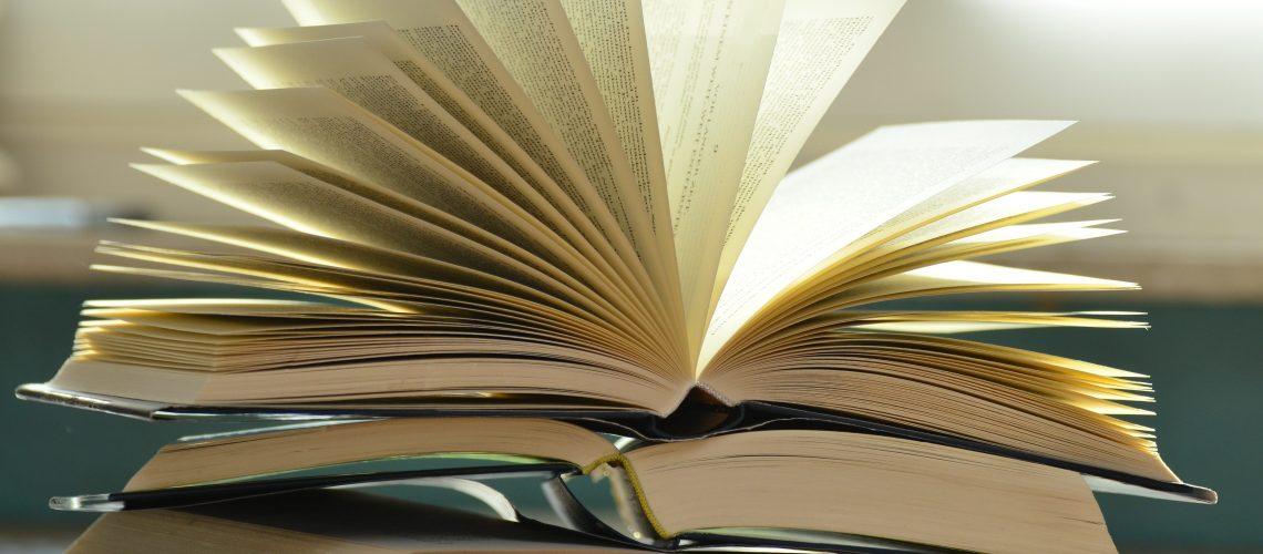 cropped-blur-books-close-up-159866.jpg